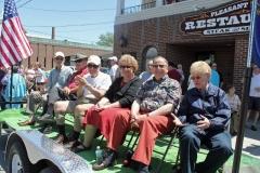 Raymond LeBouthiller, Joe St. Pierre, Paul Magoon, Carol Bennett, John Bennett and Marilyn Brody on the viewing stand