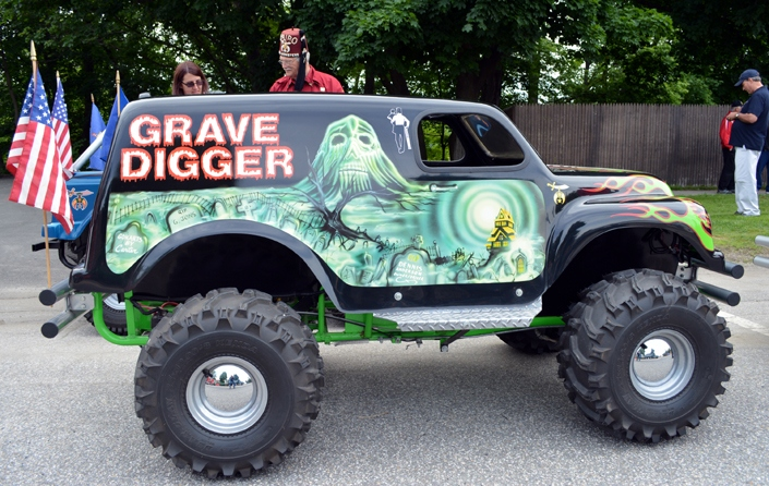 Grave Digger is one of several mini-Monster trucks that performed in the 2016 Stevens Alumni parade. My reflection can be seen in the hub of the rear wheel. (1/160 sec., F6.3, automatic-no flash mode, ISO 200, 18mm).Photo: Stephen C. Fitch June 11, 2016 9:50 AM