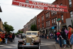Class of 1932 graduate Helen Lovell rides in a vintage 1932 Chrysler as the vehicle passes underneath the Stevens Alumni banner on Pleasant Street during the 2016 Alumni parade. At age 102, she is the oldest active member of the alumni. (1/250 sec., F8, automatic-no flash mode, ISO 200, 24mm).Photo: Stephen C. Fitch June 11, 2016 11:21 AM