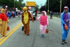 Costumed characters Winnie the Pooh, Tigger, Piglet and Eeyore walk in front of their award-winning float near the start of the 2016 Stevens Alumni parade. The parade theme was Great Books. Designed by the class of 1971, their float was awarded the George Disnard Memorial trophy. (1/250 sec., F8, automatic-no flash mode, ISO 200, 24mm).Photo: Stephen C. Fitch June 11, 2016 10:46 AM